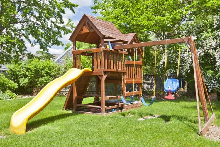 Backyard swing set - The 50 Best Backyard Swing Sets Of 2019 - Family Living Today