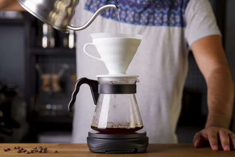Man using a pour over coffee maker